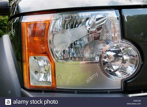 beam deflector fitted to offside headlight of a land rover