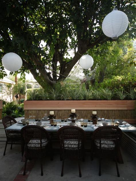 outdoor dining area with hanging paper lanterns and wicker chairs designers portfolio hgtv
