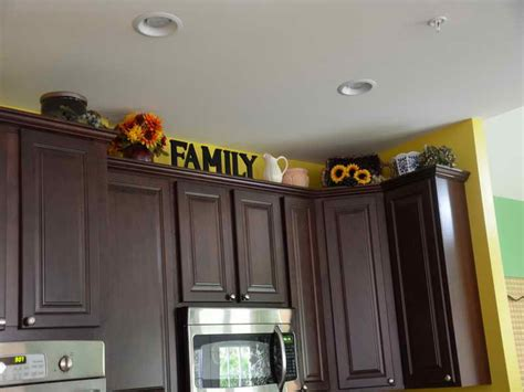 above cabinet kitchen decor kitchen how to decorate above kitchen cabinets family