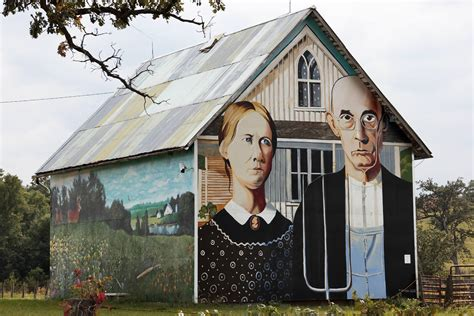 american gothic house 10 remakes of grant wood s american gothic scene360