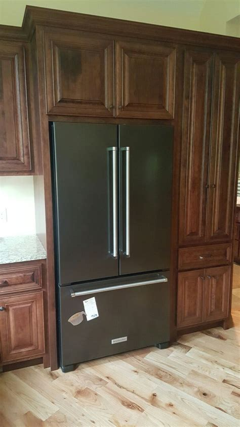 black kitchen cabinets with stainless steel appliances kitchenaid black stainless appliances with cherry cabinets