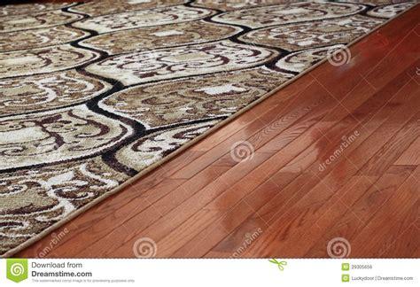 Cleaning Area Rugs On Hardwood Floors Rug Cover Hardwood Floor Royalty Free Stock Image Image 29305656
