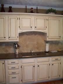 Cream Colored Kitchen Cabinets by Cream Cabinets With Dark Brown Glaze Diy Refinish