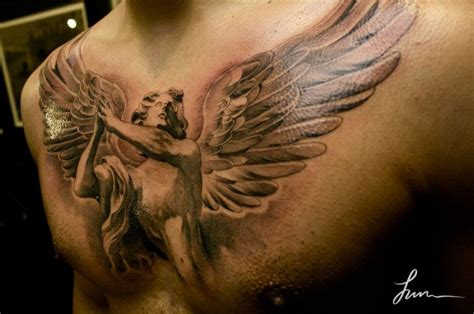 Angel Tattoo On The Chest | beautiful guardian angel tattoo on chest tattooimages biz