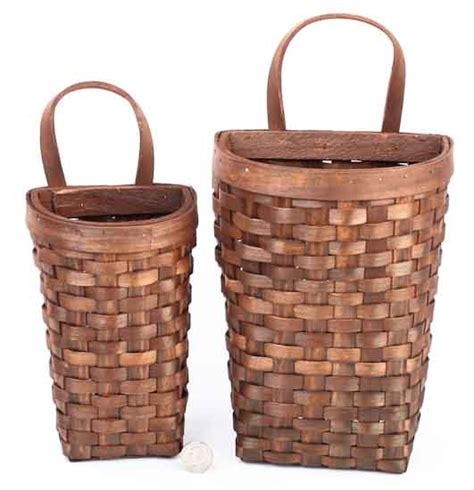 basket wall decor set of 2 primitive woven wall baskets baskets
