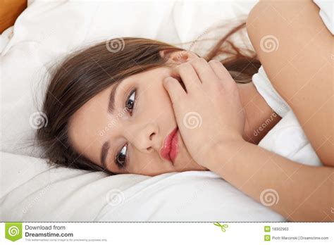 girls laying in bed young sad girl lying in bed stock photos image 18302963