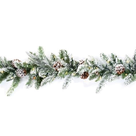 image lighted garland above white premier decorations 1 8m flocked garland with 60 warm