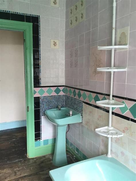 turquoise bathroom suite this period property is in need of renovation but it s