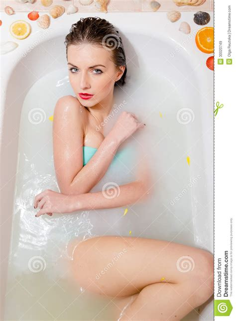 sexy in bathtub pretty woman relaxing in milk bath with flowers royalty free stock images image 30020749