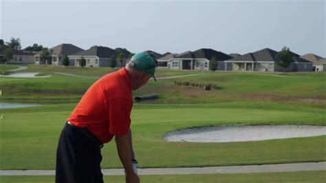 back pain after golf swing a golfer grabs his lower back and winces in pain during a