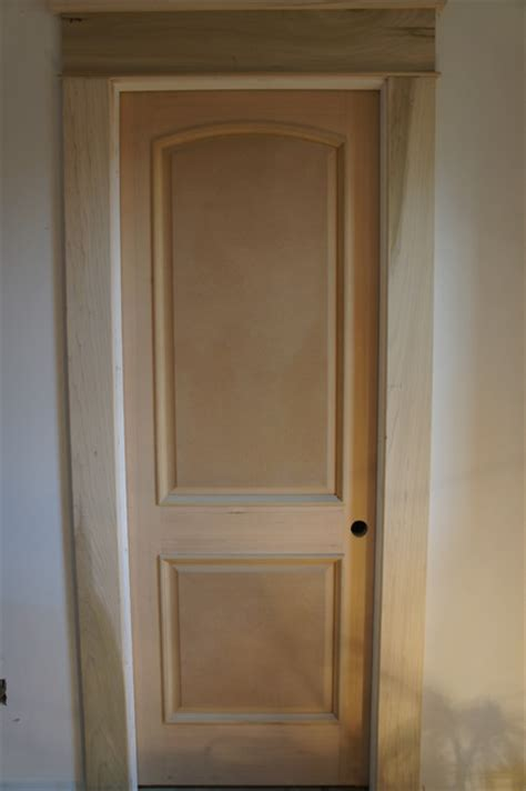 contemporary door trim 2 panel arch top raised bolection molding contemporary