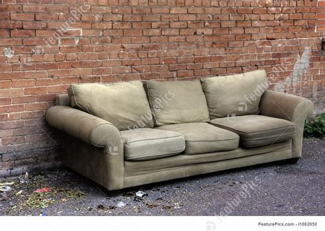 couches in alleys street life old sofa discarded in an alley stock image