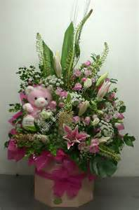 fresh flower arrangement it s a girl soft toy in fresh flowers arrangement in surprised tall big box really very big