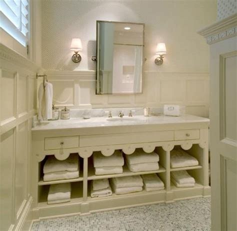 where to put towels in a small bathroom scalloped cabinet paneling on the wall bathrooms