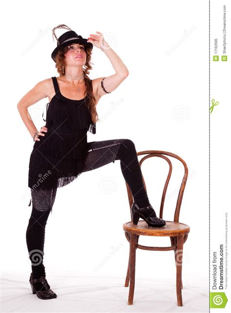 one leg wheelchair cabaret dancer posing with leg on chair royalty free stock