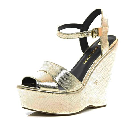 gold wedge sandals river island gold snake wedge sandals in gold lyst