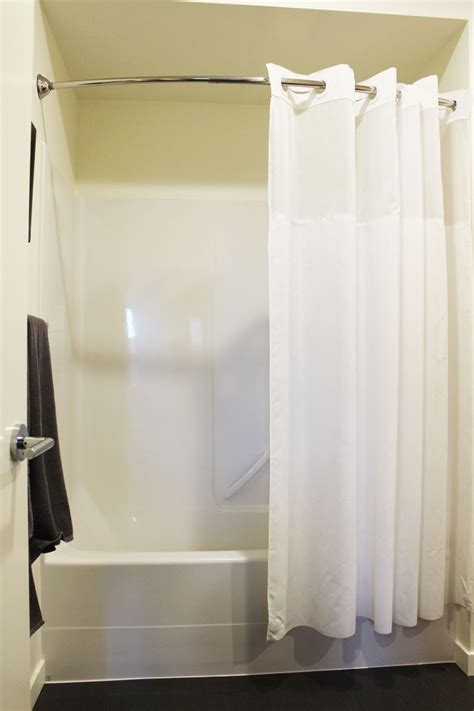 how to make a curved shower curtain rod how to decorate a bathroom without clutter