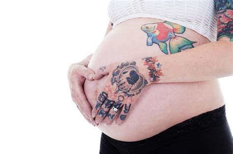 tattoo during pregnancy can you get a while safety and risks