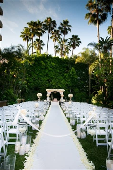 wedding aisle on grass sunset ceremony neutral toned ballroom reception in