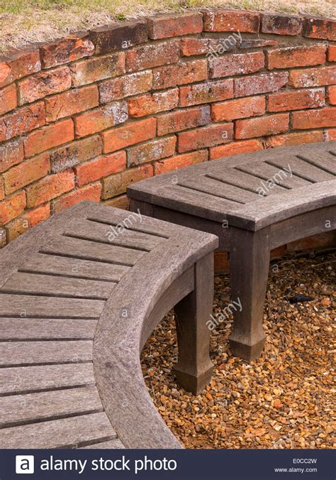 brick and wood bench curved wooden bench seat and old red brick wall coton
