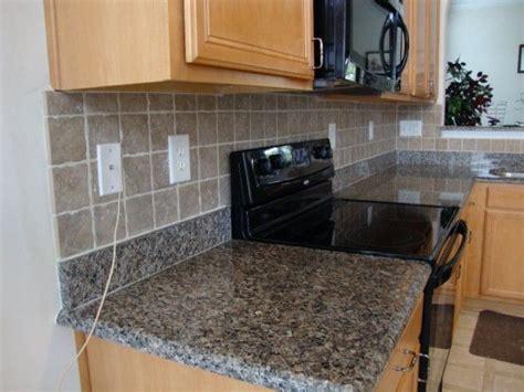 granite backsplash with tile above pin by j p hafner on back splash