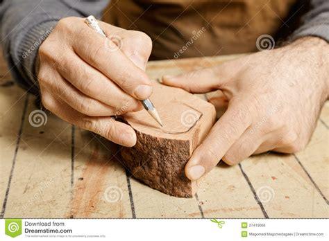 www woodworker woodworker sketching on wood billet royalty free