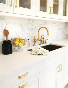 Kitchen Sink Decor White And Gold Kitchen With Black Accents Transitional Kitchen