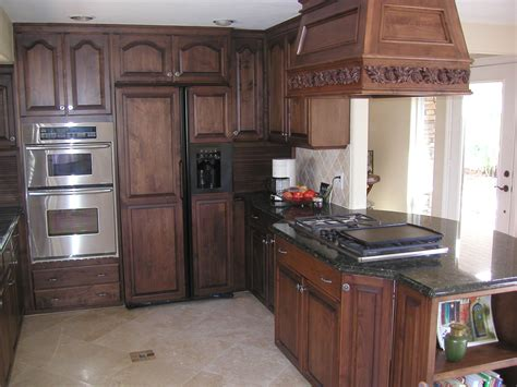 dark kitchen cabinets with dark countertops brown cherry wood cabinets white stained wooden island