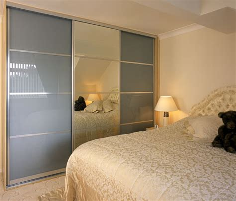 Mirrored Bedroom sliding mirror and glass doors fitted bedrooms and