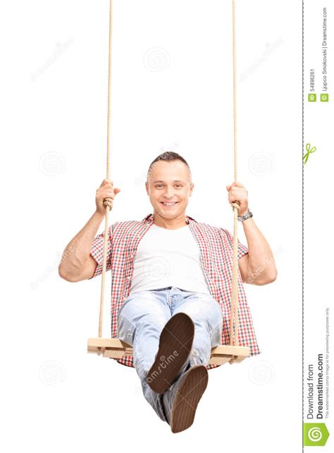 swinging man carefree young man swinging on a swing stock image image