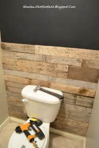 bathroom accent wall done here in pallett wood you could even do faux brick powder room idea