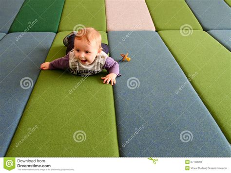 What Is The Best Mattress For A Baby Crib Baby Boy On Play Mattress Stock Image Image Of Crawls 27730893