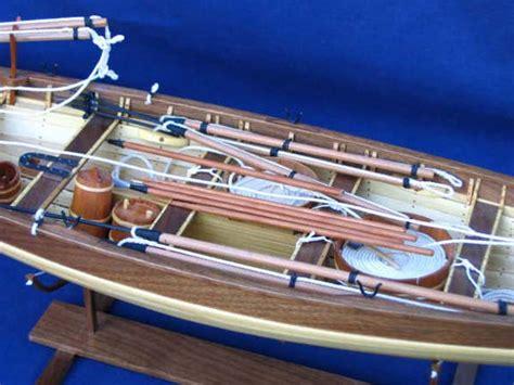 model boat builders building a model boat hull