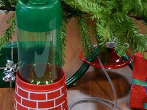christmas tree automatic waterer keeps tree fresh made