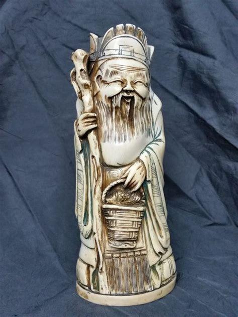speelgoed uit china importeren antiek ivoren beeld oude man china ca 1900