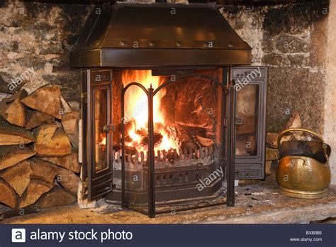 Log Burning Fireplace by Open Log With Logs Burning And Fireguard On The