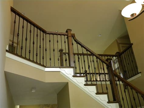 iron banister wood stairs and rails and iron balusters iron balusters
