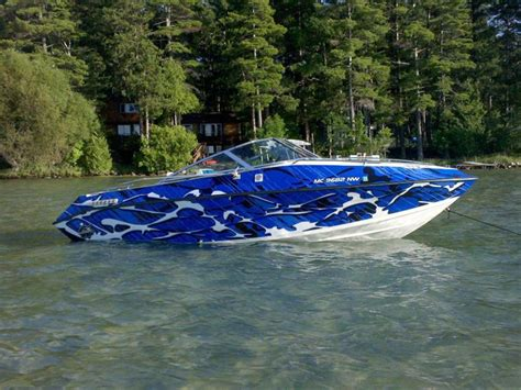 boat graphics paint blue camouflage total covering on little boat boat
