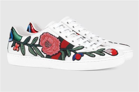 makes a statement in gucci floral sneakers