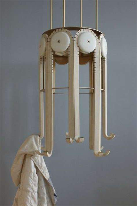 Mechanical Rack by Wooden Gear Like Hangers Respond Mechanical Coat Rack