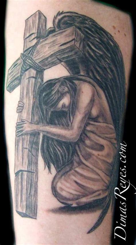tattoo angel cross kingdom studio tattoos realistic black and grey