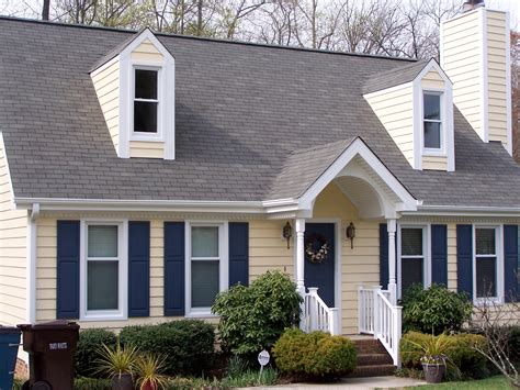 i have a blue house with a blue window 30 gray houses with blue black door and shutters experts suggestion