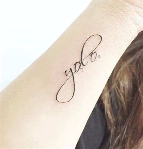yolo tattoo quot yolo quot on the forearm