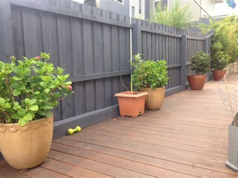 painted fence with colourbond ironstone paint colour i