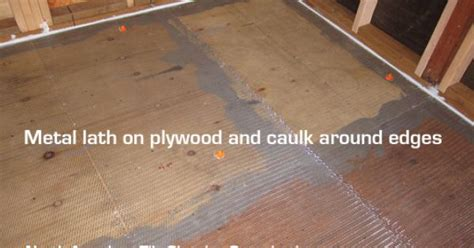metal lath on plywood on wooden subfloor before self