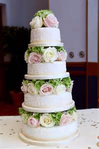 Tiered Wedding Cakes 4 Tier Fleur De Lys Wedding Cake Blocked With Fresh Flowers Small Weddingdates Co Uk Blog