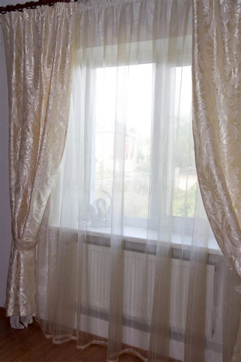 decorating windows curtains in the bedroom stock