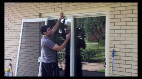 Fixing A Screen Door by Sliding Screen Door Tune Up By Home Repair Tutor