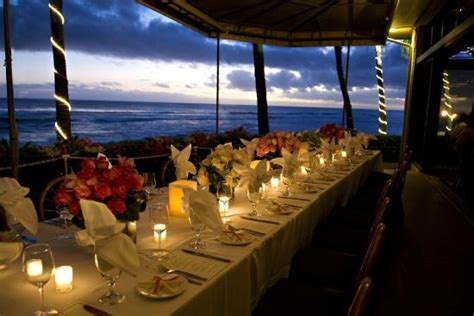 beach house restaurant a beautiful table setting overlooking the ocean for dinner service here at the beach