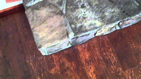 how to cut laminate flooring next to a stone fireplace